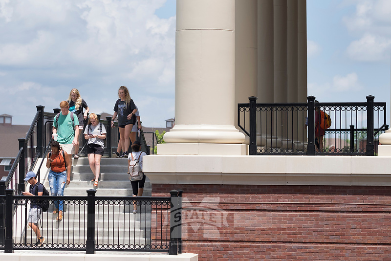 Old Main Academic Center - first day of classes.  Students walking in between classes - with pillars at front of building.<br />  (photo by Megan Bean / &copy; Mississippi State University)