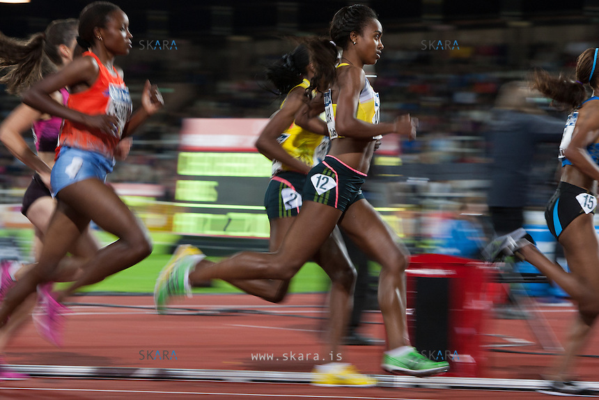DIBABA Genzebe (ETH) in yellow running in the 3000m run at the IAAF Diamond League meeting in Stockholm. She came in 8th place at her personal best time 8:37.00.