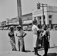 Townspeople on a street corner on Saturday morning in San Augustine, Texas. April 1943.<br /> <br /> Photo by John Vachon.