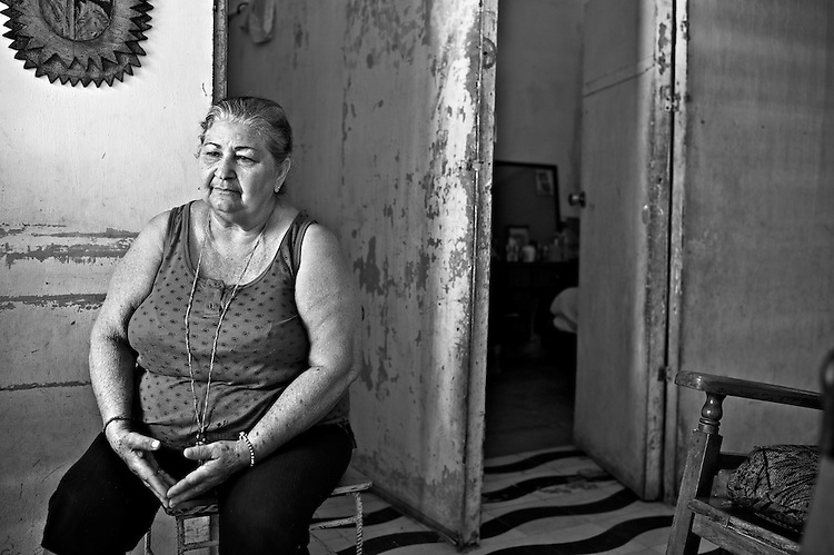 Images from the old Havana, Cuba. ..Fidelina, Encanito's wife watching TV with her door open, keeping an eye on life in the boardwalk.