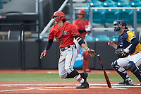 Anthony Walters (10) of the San Diego State Aztecs follows through on his swing against the UNCG Spartans at Springs Brooks Stadium on February 16, 2020 in Conway, South Carolina. The Spartans defeated the Aztecs 11-4.  (Brian Westerholt/Four Seam Images)