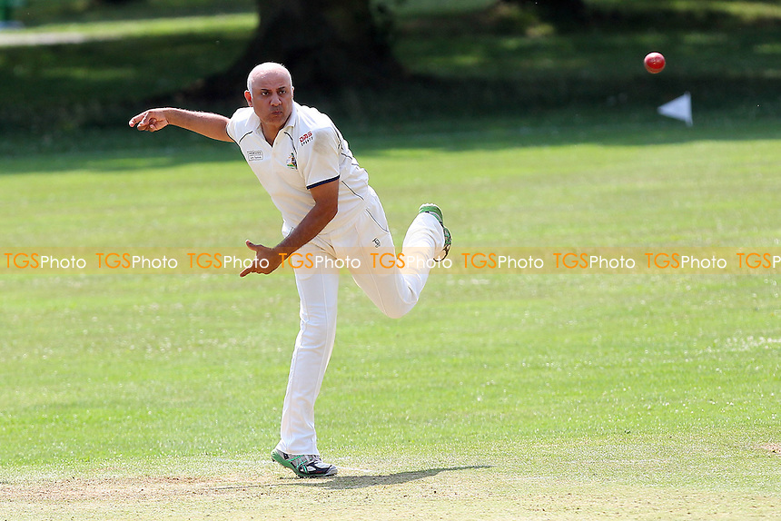 Mo Fayyaz in bowling action for Wanstead - Harold Wood CC vs Wanstead & Snaresbrook CC - Essex Cricket League at Harold Wood Park - 26/07/14 - MANDATORY CREDIT: Gavin Ellis/TGSPHOTO - Self billing applies where appropriate - contact@tgsphoto.co.uk - NO UNPAID USE
