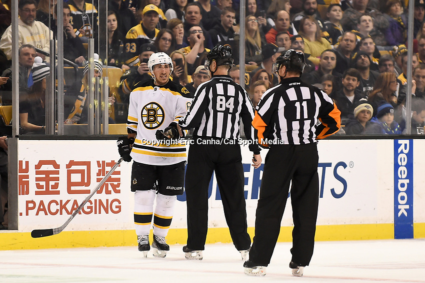 Tuesday, February 9, 2016:Boston Bruins left wing Brad Marchand (63) argues his case with linesman Tony Sericolo (84) during the National Hockey League game between the Los Angeles Kings and the Boston Bruins, held at TD Garden, in Boston, Massachusetts. The Kings defeat the Bruins 9-2. Eric Canha/CSM