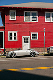 USA, Los Angeles, a car parked outside a a bright red building near Abbot Kinney Boulevard
