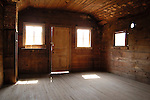 Sunlight streams through windows of the old post office in the historic ghost town of Buncom, Oregon