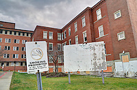 When I started work in 1980 there were no signs on the front lawn at the former Sarnia General Hospital. A faded no smoking sign still stands where smokers congregated, being backed by an even larger fund raising campaign sign promoting the new Bluewater Health hospital Norman Street site.