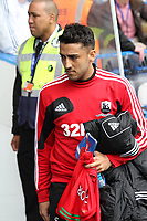 Pictured: Neil Taylor makes a return following a long injury related lay off with an apperance on the substitutes bench.<br />