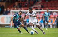 Manny Oyeleke of Aldershot Town turns Matt Bloomfield of Wycombe Wanderers during the pre season friendly match between Aldershot Town and Wycombe Wanderers at the EBB Stadium, Aldershot, England on 22 July 2017. Photo by Andy Rowland.