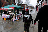 English Defence League (EDL) demonstration<br /> called in protest to the proposed building of a new mosque in Dudley.<br /> Members of the English Defence League walk past a Socialist Worker stall.