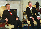 President Jiang Zemin of China and United States President Bill Clinton meet in the Oval Office at The White House in Washington, D.C. on October 29, 1997..Credit: Ron Sachs / CNP