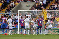 Pictured: Goalkeeper Lukasz Fabianski (TOP) grabs the ball from a Crystal Palace corner kick<br />