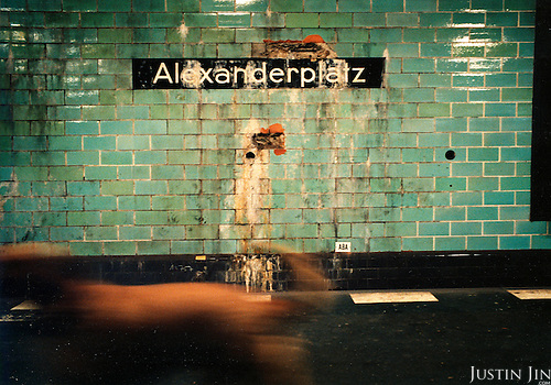 A dog walks on the platform of Berlin's Alexanderplatz metro station..Picture taken 2005 by Justin Jin