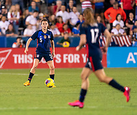 FRISCO, TX - MARCH 11: Kelley O'Hara #5 of the United States looks to pass the ball during a game between Japan and USWNT at Toyota Stadium on March 11, 2020 in Frisco, Texas.