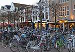 Dutch bicycles in the town square at night, Leiden, Netherlands. .  John offers private photo tours in Denver, Boulder and throughout Colorado, USA.  Year-round. .  John offers private photo tours in Denver, Boulder and throughout Colorado. Year-round.