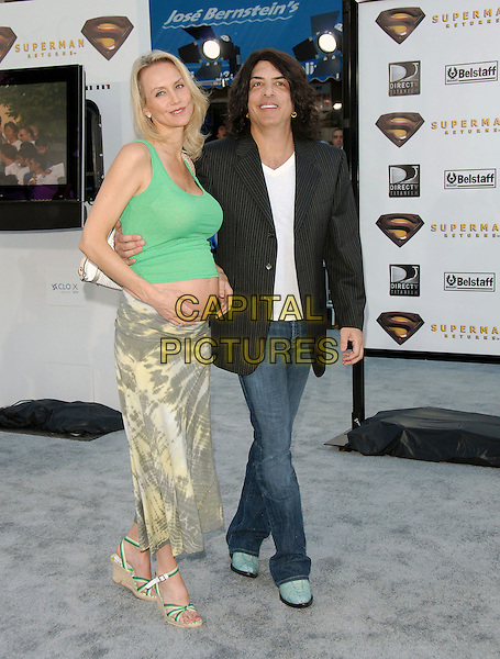 """PAUL STANLEY & WIFE.The Warner Brothers' World Premiere of """"Superman Returns"""" held at The Mann Village Theatre in Westwood, California, USA..June 21st, 2006.Ref: DVS.full length married husband wife jeans denim black jacket wedges pregnant green skirt.www.capitalpictures.com.sales@capitalpictures.com.Supplied By Capital PIctures"""