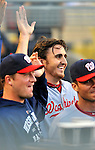 22 July 2011: Washington Nationals pitcher John Lannan is all smiles as he returns to the dugout after hitting a game-winning, 2-run homer in the 2nd inning against the Los Angeles Dodgers at Dodger Stadium in Los Angeles, California. The Nationals defeated the Dodgers 7-2 in their first meeting of the 2011 season. Mandatory Credit: Ed Wolfstein Photo