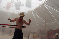 BLACK ROCK CITY,NV - AUGUST 30, 2008: On Saturday a dust storm created a 'white out', at  Burning Man event, August 30, 2008. people gathered in the center camp took what shelter there was from the wind and dust and made the best of it.