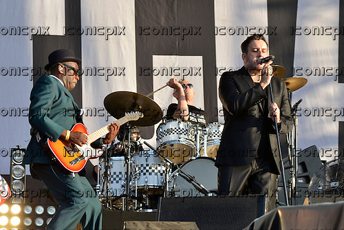 THE SPECIALS - L-R: Lynval Golding, John Bradbury, Terry Hall - performing live at the BT London Live 2012 Olympic Concerts in Hyde Park London UK -12 Aug 2012.  Photo credit: George Chin/IconicPix