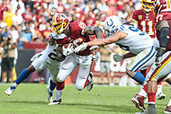 Landover, MD - September 16, 2018: Washington Redskins running back Adrian Peterson (26) gets tackled by several Indianapolis Colts defenders during the  game between Indianapolis Colts and Washington Redskins at FedEx Field in Landover, MD.   (Photo by Elliott Brown/Media Images International)