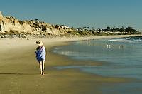 Woman Walking Along the Beach in Orange County