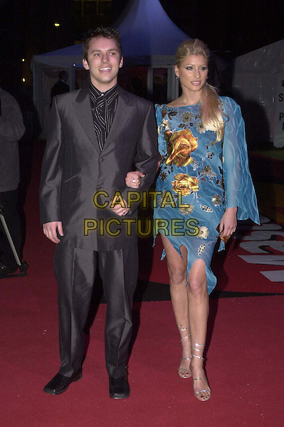 TREY FARLEY & DANI BEHR .Arrivals for the Brit Awards at Earls Court.  .chiffon mini dress, strappy heels, floral, hair extensions, full length, full-length.*RAW SCAN - photo will be adjusted for publication*.www.capitalpictures.com.sales@capitalpictures.com.© Capital Pictures