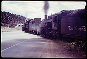 &quot;276-5 just out of Durango the double-header crosses US 550.&quot;<br /> D&amp;RGW  Durango, CO  Taken by Owen, Mac - 6/1975