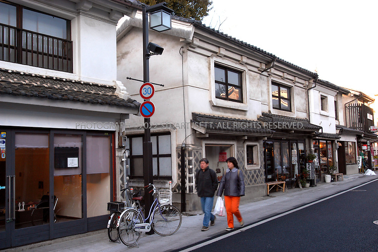 December 14, 2002, Matsumoto, Japan: Along the banks of the Metoba River, one finds shops dating from the early Edo period, built in the kura style, with decorative walls of white plaster and black beams  Photograph by Stuart Isett ©2002 Stuart Isett All rights reserved. Credit: Stuart Isett / Polaris