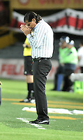 BOGOTA - COLOMBIA - 11-03-2015: Flabio Torres, tecnico Once Caldas, da instrucciones a los jugadores durante partido por la fecha 9 entre Independiente Santa Fe y Once Caldas de la Liga Aguila I-2015, en el estadio Nemesio Camacho El Campin de la ciudad de Bogota. / Flabio Torres, coach of Once Caldas, gives instuctions to the players during a match of the 9 date between Independiente Santa Fe and Once Caldas for the Liga Aguila I -2015 at the Nemesio Camacho El Campin Stadium in Bogota city, Photo: VizzorImage / Luis Ramirez / Staff.