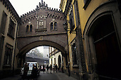 Kracow, Poland. Brick arch over a road with castellated building on it.