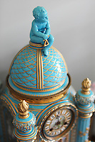 An antique clock with gilt and turquoise enamel decoration