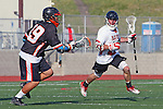 Palos Verdes, CA 04/27/12 - Zach Henkhaus (Palos Verdes #12) and Grayson Kim (Beverly Hills #39) in action during a regular season CIF Boys Lacrosse game between Palos Verdes and visiting Beverly Hills, Palos Verdes defeated the visitors 18-3.