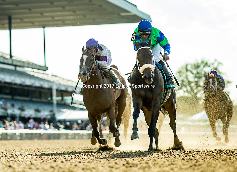 ELMONT, NY - JUNE 09: By The Moon #9 and Rajiv Maragh hold off Lightstream to win in the Bed o' Roses Invitational Stakes at Belmont Park on June 9, 2017 in Elmont, New York. (Photo by Alex Evers/Eclipse Sportswire/Getty Images)