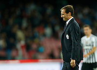 Juventus' coach  Massimiliano Allegri leaves the field  during the  italian serie a soccer match against   SSC Napoli,    at  the San  Paolo   stadium in Naples  Italy , September 26 , 2015