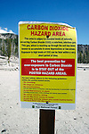 CARBON DIOXIDE HAZARD AREA SIGN<br /> Hazardous CO2 Gas Leaches Through Soil<br /> Warning signs are posted near Horseshoe Lake in Inyo National Forest, indicating to visitors that present carbon dioxide levels are potentially hazardous. It is believed the CO2 is being released from a large gas reservoir deep under Mammoth Mountain.