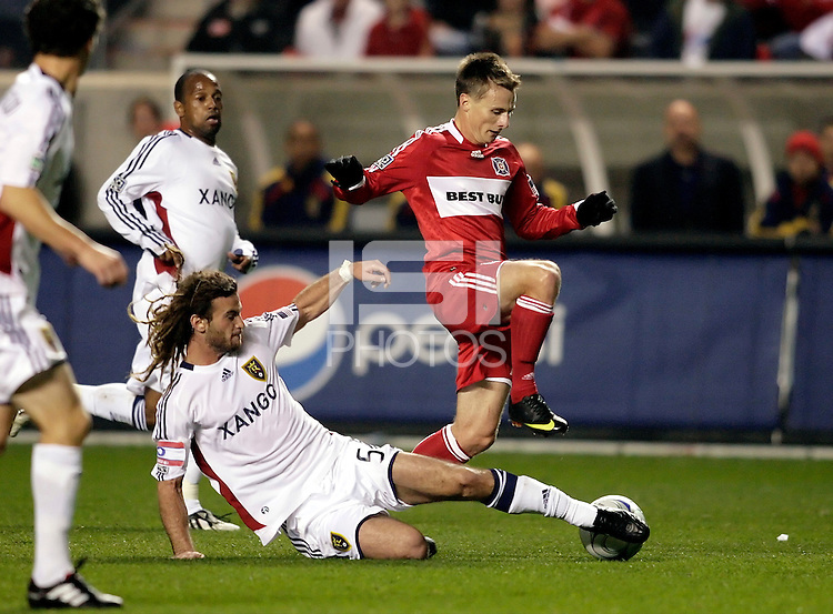 Real Salt Lake midfielder Kyle Beckerman (5) slide tackles the ball away from Chicago Fire midfielder Chris Rolfe (17).  Real Salt Lake defeated the Chicago Fire in a penalty kick shootout 0-0 (5-4 PK) in the Eastern Conference Final at Toyota Park in Bridgeview, IL on November 14, 2009.