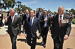 AUSTRALIA, Canberra : Australian War Memorial Director Brendan Nelson (L), French President Francois Hollande (C) and War Memorial Chairman Ken Doolan (R) walk together after planting a tree in the Memorials grounds, Canberra on November 19, 2014. Hollande is on a two-day state visit to Australia following the G20 Summit over the weekend. AFP PHOTO / MARK GRAHAM