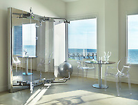 The gym with its modern equipment has fabulous views of the sea through large picture windows