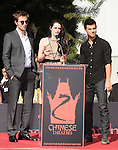 Robert Pattinson,Kristen Stewart and Taylor Lautner attends the  TWILIGHT : Kristen Stewart, Robert Pattinson And Taylor Lautner Hand And Footprint Ceremony held at The Grauman's Chinese Theatre in Hollywood, California on November 3,2011                                                                               © 2011 DVS / Hollywood Press Agency