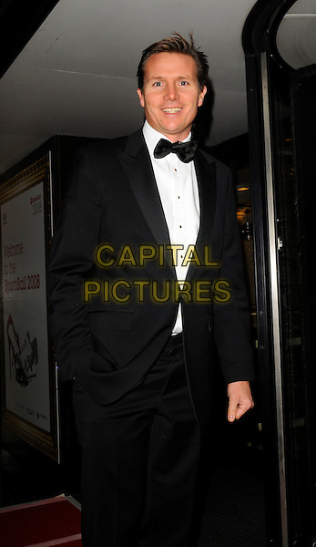 ROGER BLACK .The Sports Ball 2008, Grosvenor house Hotel, London, England..October 2nd, 2008.half length black tuxedo jacket bow tire hand in pocket .CAP/CAN.©Can Nguyen/Capital Pictures.