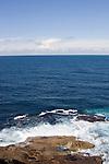 Waves crash along the coastline of New South Wales, Australia