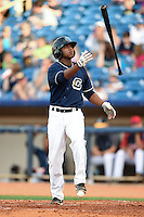 Lake County Captains outfielder Dorssys Paulino (17) flips his bat during a game against the Dayton Dragons on June 7, 2014 at Classic Park in Eastlake, Ohio.  Lake County defeated Dayton 4-3.  (Mike Janes/Four Seam Images)
