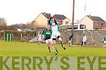 Diarmuid Herlihy of Na Gaeil breaks beats Kevin Forde of Granagh/Ballingarry to the ball in the Muster Junior B Football Final last Sunday afternoon in Knockaderry.
