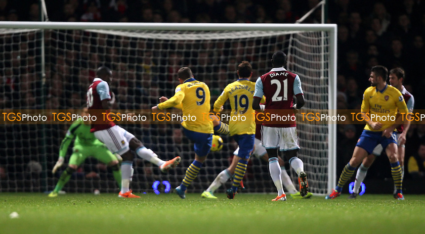 Lukas Podolski scores the 3rd goal for Arsenal - West Ham United vs Arsenal, Barclays Premier League at Upton Park, West Ham - 26/12/13 - MANDATORY CREDIT: Rob Newell/TGSPHOTO - Self billing applies where appropriate - 0845 094 6026 - contact@tgsphoto.co.uk - NO UNPAID USE