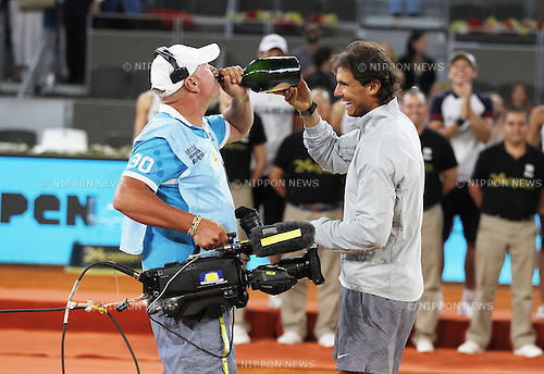 Rafael Nadal (ESP), MAY 11, 2014 - Tennis : Rafael Nadal of Spain makes a tv crew drink champagne after the men's singles final ceremony of the Mutua Madrid Open tennis tournament at the La Caja Magica in Madrid, Spain, May 11, 2014. (Photo by AFLO)