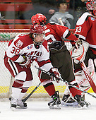 Conor Morrison (Harvard - 38), George Hughes (St. Lawrence - 15) - The Harvard University Crimson defeated the St. Lawrence University Saints 4-3 on senior night Saturday, February 26, 2011, at Bright Hockey Center in Cambridge, Massachusetts.