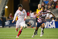 Li Wen (23) of China PR (CHN) is marked by Shannon Boxx (7) of the United States (USA). The United States (USA) women defeated China PR (CHN) 4-1 during an international friendly at PPL Park in Chester, PA, on May 27, 2012.