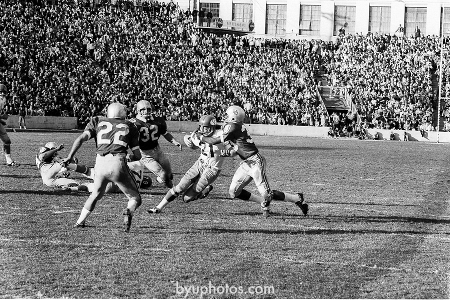 FTB 06 A 26 Utah<br /> <br /> Football BYU-Utah (at SLC), Kent Oborn's TD Series, Paul Erhman, Max Newberry. 21 Casey Boyett.<br /> <br /> Nov. 12, 1966<br /> <br /> Box Number: 6373<br /> <br /> Photo by: Hal Williams/BYU<br /> <br /> Copyright BYU PHOTO 2008<br /> All Rights Reserved<br /> 801-422-7322<br /> photo@byu.edu