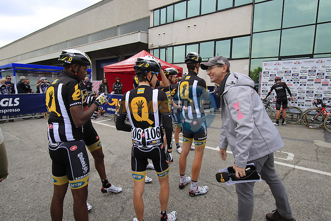 MTN-Qhubeka team riders sign on for the start of the 2015 96th Milan-Turin 186km race starting at San Giuliano Milanese, Italy. 1st October 2015.<br /> Picture: Eoin Clarke | Newsfile
