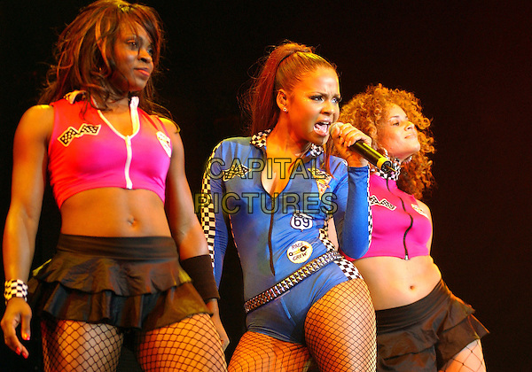 CHRISTINA MILIAN.Performs during a tour stop held at Mellon Arena..October 7th, 2004.stage, concert, live, music, gig, singing, half length, blue bodysuit, checkered, dancers, dancing, singing.www.capitalpictures.com.sales@capitalpictures.com.© Capital Pictures.