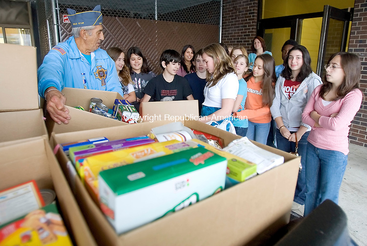 NAUGATUCK, CT. 20 November 2007-112007SV02--Bill Matos of the Veterans Who Care Committee in Naugatuck collects more than 500 cans and goods from the student council at City Hill Middle School in Naugatuck Tuesday. The goods go to veterans in need.<br /> Steven Valenti Republican-American